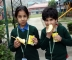 Children relishing refreshment after tiresome race